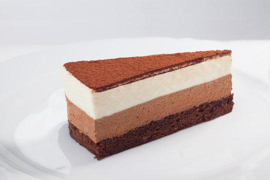 three chocolate cake slice isolated on white background