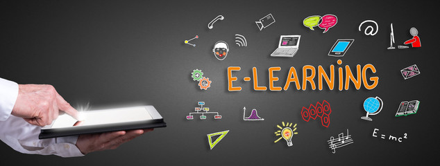 E-learning concept with man using a tablet