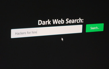 Searching for Hackers For Hire on a Dark Web Search engine, concept for deep web and illegal online service markets