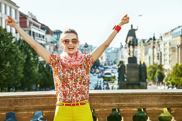 tourist woman on Wenceslas Square in Prague rejoicing Wall mural