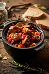 Colorful crock of Hungarian beef goulash