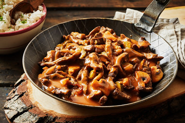 Metal skillet filled with rich beef stroganoff