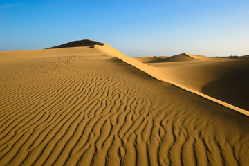 Sand dunes on the beach of Maspalomas, Gran Canaria, Spain