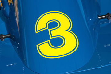 Wall Mural - yellow number three on a race car