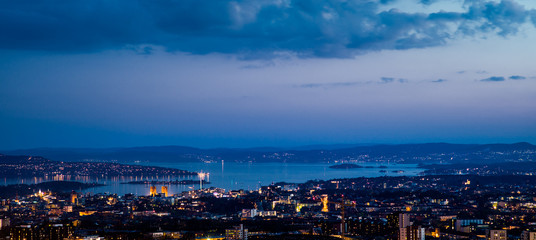 View over oslo after sunset, toward the south. The Oslo fjord and the City Hall.