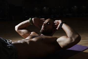 Fitness model exercising sit ups and crunches. Muscular well bui
