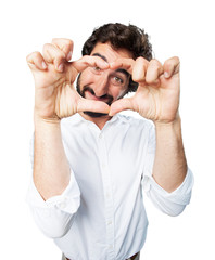 young funny man heart sign. proud pose