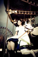 Young Woman Enjoying A Carousel Ride
