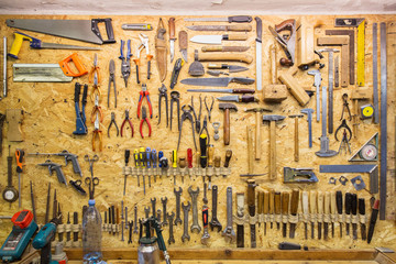 work tools hanging on wall at workshop