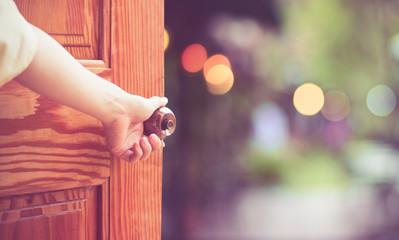 Women hand open door knob or opening the door. Wall mural