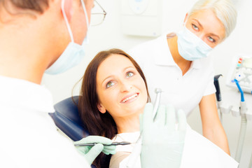Young Woman Getting A Treatment At The Dentist