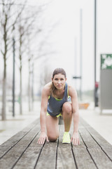 Woman in starting position on wooden bench