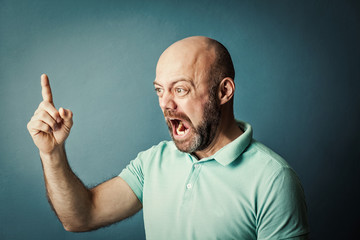 Frustrated desperate bearded middle-aged  man screaming