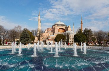 Hagia Sophia (Ayasofya) museum and fountain view from the Sultan Ahmet Park in Istanbul, Turkey