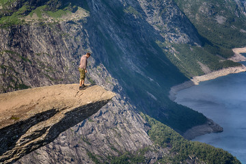 Trolltunga, Norway - July 21, 2016: Trolltunga rock with a characteristic shape located in Norway on the border of the Hardangervidda plateau, close to the town Tyssedal.