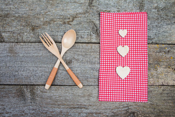 Romantic dinner on Valentines Day: wooden spoon and fork