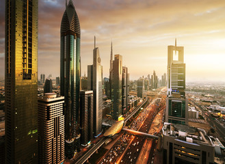 Fotomurales - Dubai skyline in sunset time, United Arab Emirates