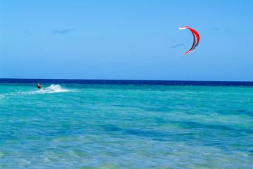 Man practicing kitesurf on Mayotte island, France