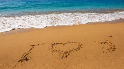 Message i love you on sand beach