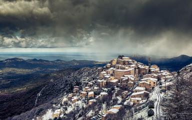 Snow on mountain village of Speloncato in Corsica