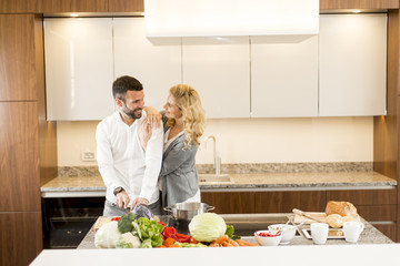 Loving couple in the modern kitchen