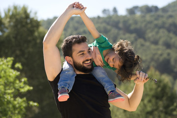 Father and baby girl playing outdoors