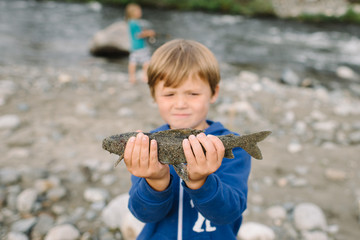 Boy holding fish, National Park, Alaska, North America