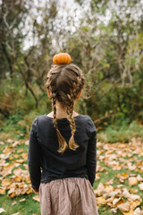 Girl with pumpkin on her head