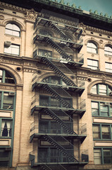Fire escape on a building in New York, USA, Vintage filtered style