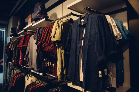 Men clothes store. Stylish men's youth clothes in shopping clothes store. Shopping concept