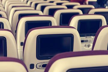 Economy class airplane interior.