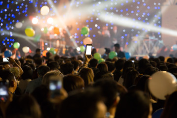 Cheering crowd in new year party,  holiday celebration background