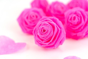 Pink rose fabric flower and small hart on white background for V