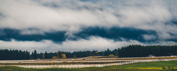 Wall Mural - Low clouds in the countryside.
