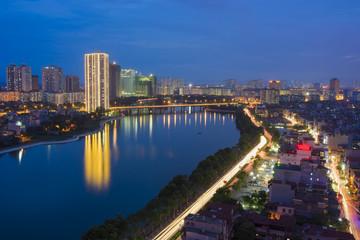 Hanoi skyline cityscape at twilight period. Linh Dam lake