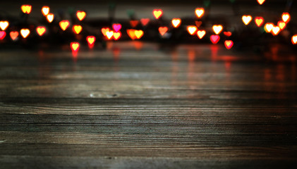 Heart bokeh, Valentine's day concept on wooden background