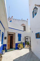 Traditional white and blue washed houses in side alley of historical Moroccan town Asilah, Morocco, North Africa
