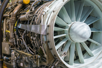 Military fighter Jet engine inside - Airplane gas turbine engine detail - Plane rotor under heavy maintenance.