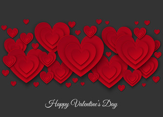 Valentines day  red  cut paper hearts on black background.