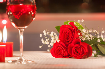Beautiful roses in a romantic candle light dinner setting.