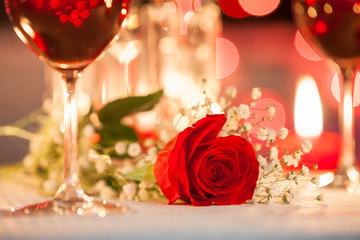 Beautiful rose in a romantic candle light dinner setting.