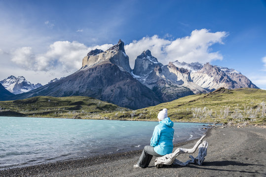 Girl on the observation deck on the lake. Los Cuernos, Torres del Paine National Park, Patagonia, Chile