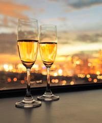 Pair of champaign alcoholic drinks in a luxury city setting.