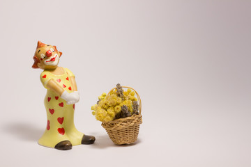 Clown and a basket of flowers