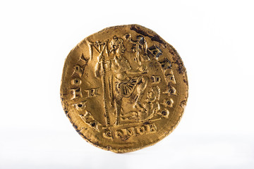 Ancient Roman gold solidus coin of Emperor Honorius. Reverse.