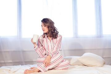 girl pyjamas bed morning cup