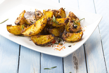 Fried potatoes grill spices spina spinach tomato salad food fresh healthy cook