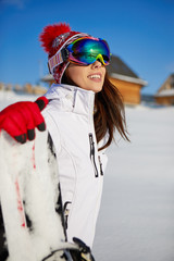 Sport woman  snowboarder on snow over blue sky