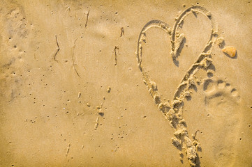 Heart and Footprint in the sand
