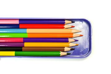 Colorful crayon, color pencil in blue box